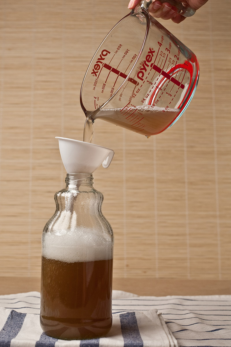 storing soap nut liquid into bottle