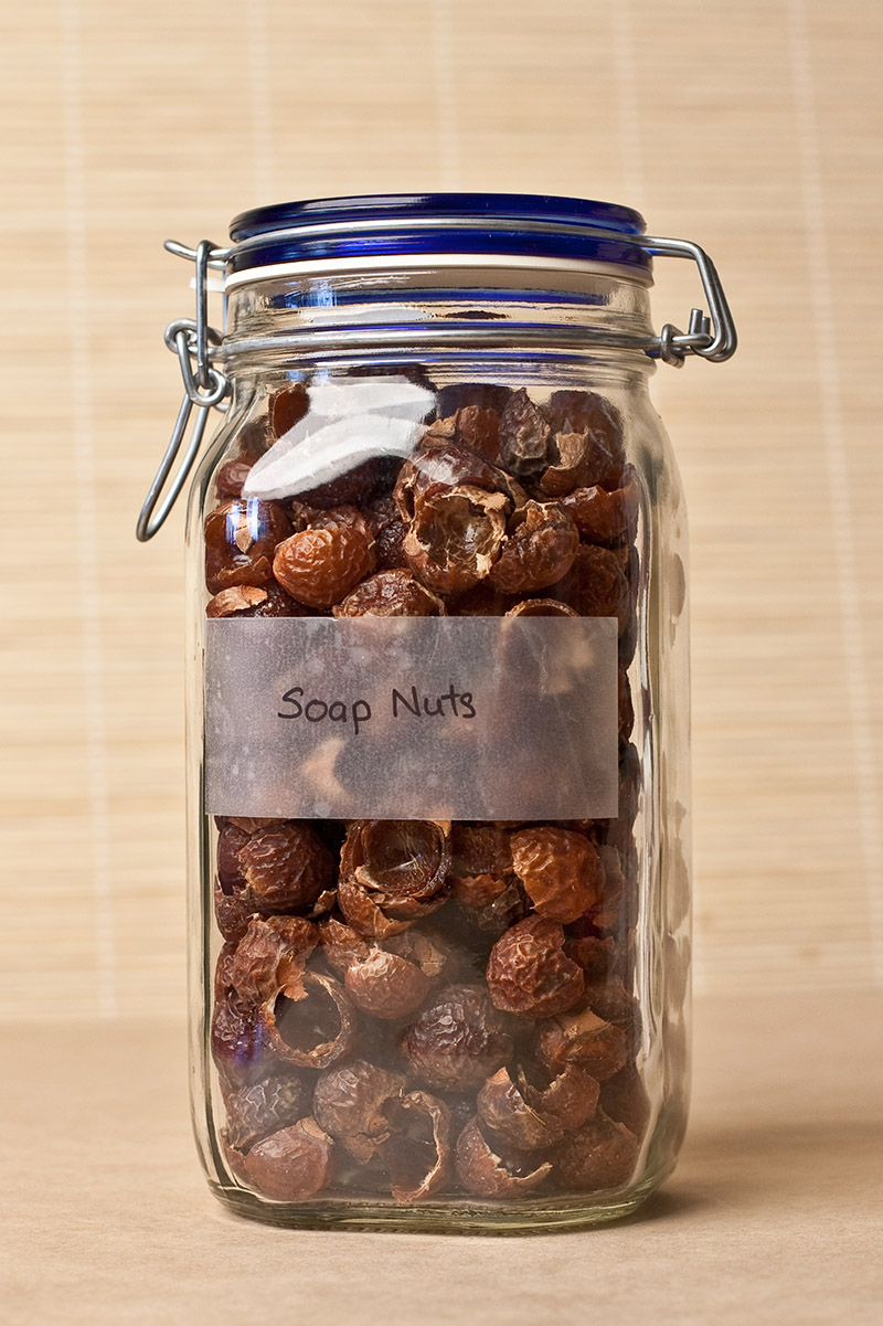 soap nuts stored in a glass bottle